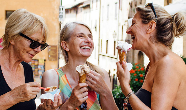 Women laughing with friends